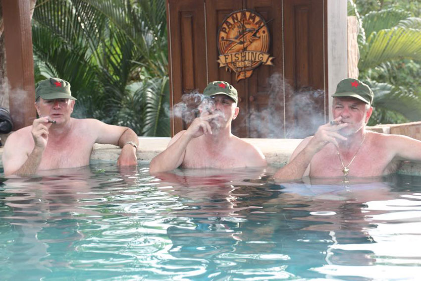 Guys having a cigar in our resort pool.
